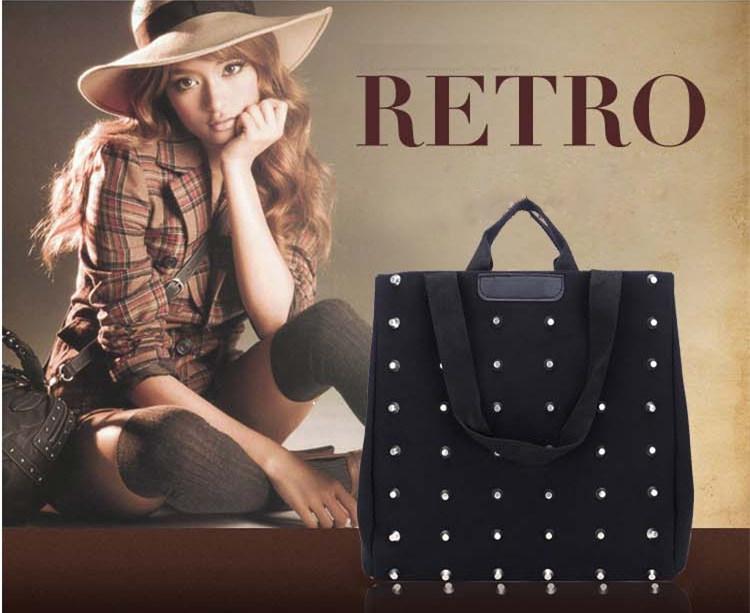 Текстильная черная сумка-уикендер в металлические заклепки - 1